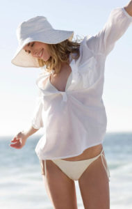 gallery-1434103680-happy-woman-on-beach